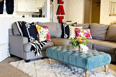 Use a rug to add texture and depth to your room while also breaking up the carpet! Colorful pillows to bring life to your couch! All details listed!!