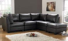 what wall color goes with black furniture | Minimalist Corner Area Furniture Black Sofas Wooden Floor Cream Rug