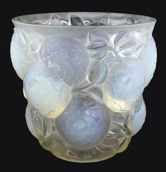 RENE LALIQUE 'ORAN' An opalescent glass vase, model introduced 1927 Marcilhac 999 10.6 in.(26.5 cm.) high wheel-carved R. LALIQUE FRANCE