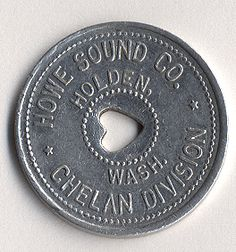 """Scrip, or """"company money,"""" was common in employer-owned communities. This is """"tin,"""" one of the small coins issued to Holden residents. Many companies issued scrip as paper, and a few as wood. Company Town, What Is Life About, Pacific Northwest, Tin, Money, Paper, Wood, Silver, Woodwind Instrument"""