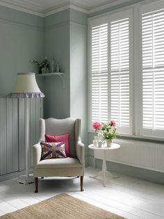 Full height cloudy white painted shutters in Elm wood, 2.5 inch (64mm) slats with front pushrods.