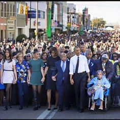 President Barack Obama and Michelle Obama, marching with outstanding black leaders.