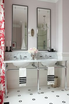 source: Sarah Richardson Design  Lavender walls paint color, marble top 3-leg washstand with double sinks, vintage penny tiles floor and red Chinoiserie toile curtains.