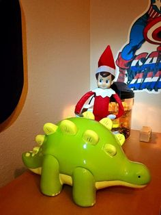 Kade was ecstatic to find Arthur in his room slipping a quarter into his dino bank! #boymom #elfontheshelf #savings