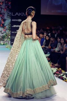 Luscious lengha :: love the bold use of mint green with neutrals. The heavily embroidered chunni still looks delicate and doesn't take away from the gorgeous skirt! By Shyamal & Bhumika