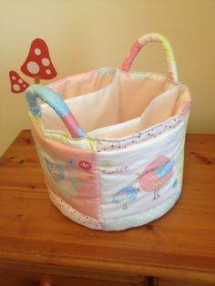 The 4th Project for our first baby's nursery - Quilted organiser basket for storing and organising all the changing stuff for downstairs. Nappies fit in the middle section and wipes/ cotton wool/ cream/ powder/ cloths fit in the sides. By Jen (me) @ Squirrelings.co.uk