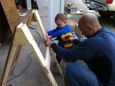 Building a scrap wood-art-easel with a child.