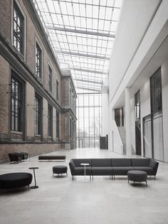 An atrium space to die for. Love the aluminium windows and light drenching the…