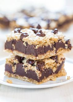 Fudgy Oatmeal Chocolate Chip Cookie Bars - Chewy bars with a thick layer of fudge in the middle