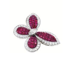 H & D Diamonds is your direct contact to diamond trade suppliers, a Bond Street jeweller and a team of designers.www.handddiamonds... Tel: 0845 600 5557 - PLATINUM, MYSTERY-SET RUBY AND DIAMOND BROOCH, VAN CLEEF & ARPELS