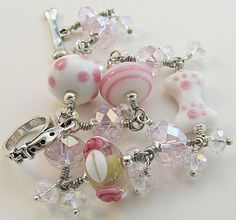 Pink Dog Bone Bracelet with artisan lampwork beads and paw print dog bone.  For Love of a Dog Jewelry & Gifts