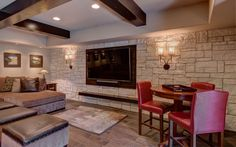 This basement remodel was made to last with timeless stone, dark wood, and stain glassed features that will be beautiful for a lifetime. Get your basement remodel started today with the basement experts at FBC Remodel! Finished Basement Company, Living Area, Living Spaces, Wet Bars, Basement Remodeling, Home Theater, Dark Wood, Small Bathroom, Home Kitchens