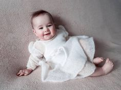 This simple ivory baptism dress for a little girl is delicately decorated with little wings on the shoulders and a thin elegant belt. Made from a luxurious, light brushed yarn in an exclusive mix of mohair super kid and silk. Knitting For Kids, Baby Knitting, Baby Girl Dresses, Baby Dress, White Baptism Dress, Vintage Baptism, Baby Blessing Dress, Stylish Toddler Girl, Kids Winter Fashion