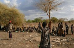 Internally displaced people of the Murle tribe wait to receive World Food Programme food rations in the Sudanese town of Pibor in Jonglei State in 2009