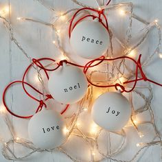Love, Peace, Noel And Joy Ceramic Baubles from notonthehighstreet.com