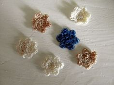Delicate little crocheted flowers, made using embroidery thread. From Tea and a Sewing Machine at www.awilson.co.uk.