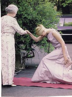 A beautiful royal curtsy... Crown Princess Mette-Marit wife of Crown Prince Haakon of Norway curtsies to Queen Elizabeth II of England.
