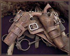 Some cowboy gun rigs and a Bowie........