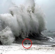 Incredible moment as surfers (in red circle) are hit by 50ft wave - Photo by UK Daily Mail