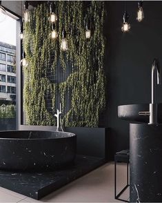 LOFT on Extraordinary black marble bathtub with an beautiful plant wall . This bathroom is definitely a displaying the hottest interior trends for Dream Home Design, Home Interior Design, Interior Architecture, House Design, Interior Designing, Luxury Interior, Interior Plants, Interior Modern, Interior Ideas