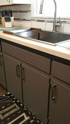 This is such a nice re-do, I wanted to share it, even though it's nothing I'll be doing.  These colors will bring your outdated kitchen back to life!