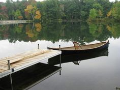 Cedar topped dock with a custom built Adirondack Pack Boat.