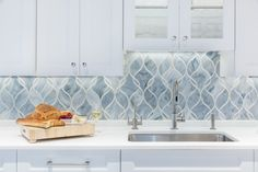 Artistic Tile I Interior designer JGL Interiors chose to do a custom Artistic Tile backsplash for her Woodmere, NY client's kitchen. With the help of our NYC A&D Showroom Manager, Claudia DiFabio, our Claridges pattern was crafted in Mingus Grey and Ice White Jazz Glass for a cool, clean and contemporary look.