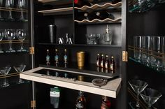"""""""Dionysus"""" - A cocktail cabinet made from black Valchromat and rippled Sycamore wine shelfs. By Roi Klifi"""