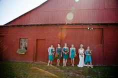 teal bridesmaid dresses in front of a red barn...be still my rustic loving heart - captured by http://www.marvelousthingsphotography.com