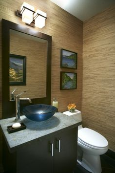 Love the soothing grass cloth in this powder room