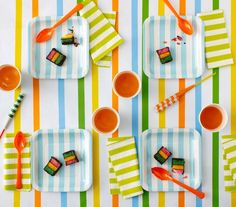 Start with a white tablecloth (paper or plastic covering will work) and add stripes, which you can make with colorful tape.