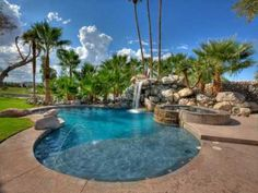 Wayne Newton stunning tropical pool with palm trees and waterfall.
