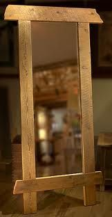 PALLET MIRROR FRAME - make your own and attach to a wall... old mirrors are available at recycle centres and put your style on it.
