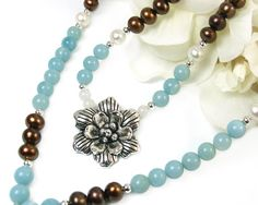 Hey, I found this really awesome Etsy listing at https://www.etsy.com/listing/251912331/blue-brown-necklace-flower-pendant
