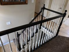 Stair bannister refinished by Chameleon Painting SLC, UT in espresso brown/black and pure white spindles.
