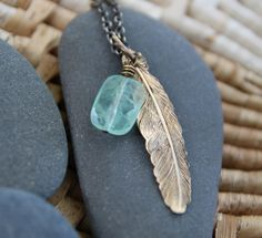 As you wear your necklace, see it as a reminder that you can feel your wings, breathe deeply, and make the choice to fly when it serves you. :: Feather love necklace with fluorite to aid intuition.