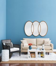 Make a statement with a larger-scale wall piece, like this contemporary linked oval mirror.
