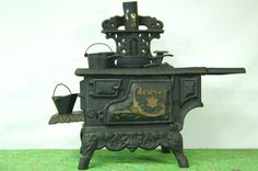 1940s Crescent Cast Iron Toy Stove  Salesmans by TheVintageTrekker
