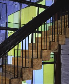 Large timber beams form the treads for this straight staircase