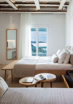 A luxurious suite with sea views at the Bill & Coo Suites and Lounge in Mykonos, Greece