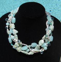 Raw and polished amazonite with pearls and silver beads. Featured in Pelican Post Magazine.