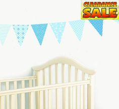 A simple idea to decorate a little boy's #nursery, bedroom or playroom with gorgeous #Pennant Wall Decals filled with cute patterns in shades of blue from FunToSe...
