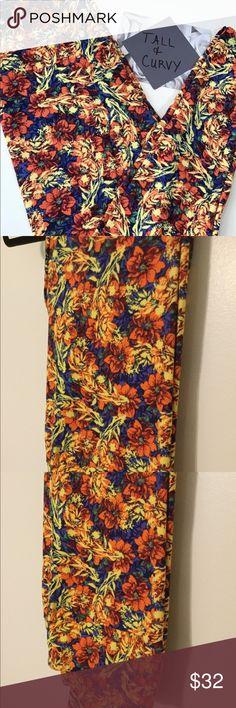 New! Leggings. Beautiful floral. LuLaRoe TC Beautiful floral. LuLaRoe TC leggings. First is just a Stock photo. Not a consultant. New! Hung to photograph. LuLaRoe Pants Leggings