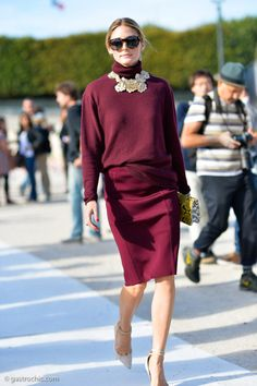 Olivia Palermo upgrades a burgundy skirt and sweater combo with a stunning statement necklace.