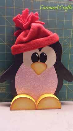 Cute little penguin with fleece hat.  This is a shelf sitter