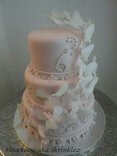 Snow White Butterflies, Silver Pearls on a Light pink Fondant Wedding Cake
