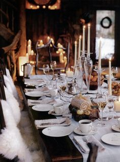 Dinner by firelight at winter time, complete with faux fur throws and and candle arrangements.