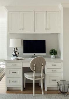 Home Interior Wood A gray round back chair sits at a white built-in kitchen desk boasting white drawers donned with polished nickel pulls. Kitchen Office Nook, Kitchen Desk Areas, Kitchen Desks, Home Office Space, Home Office Design, Home Office Furniture, Home Office Decor, Kitchen Desk Organization, Kitchen Work Station