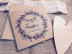 Rustic wreath personalised wedding invitation. This vintage shabby chic rustic invitation design has been created using 300gm Kraft Card with matching kraft brown envelope.