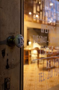 """In""spired doorknob. Design of Athen's Capanna Trattoria by K-Studio, Photographs by Yiorgos Kordakis."